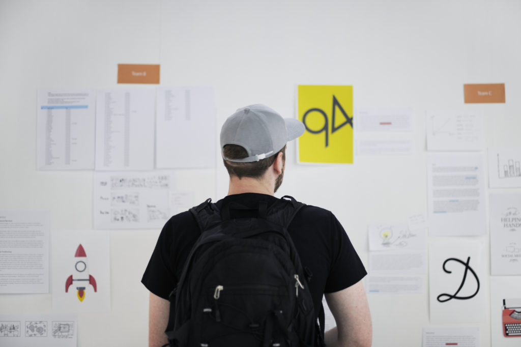 Man looking at board at a Daily Scrum